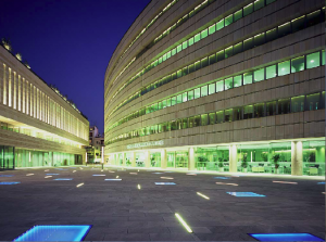 Buzon pedestals in illuminated terrace shown at night